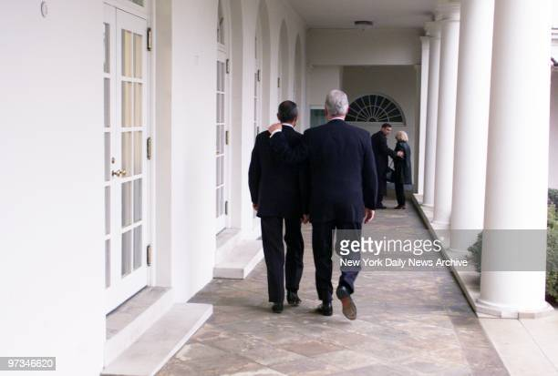 President Bill Clinton leaves the Oval Office for the last time He walks down the colonnade with his Chief of Staff John Podesta