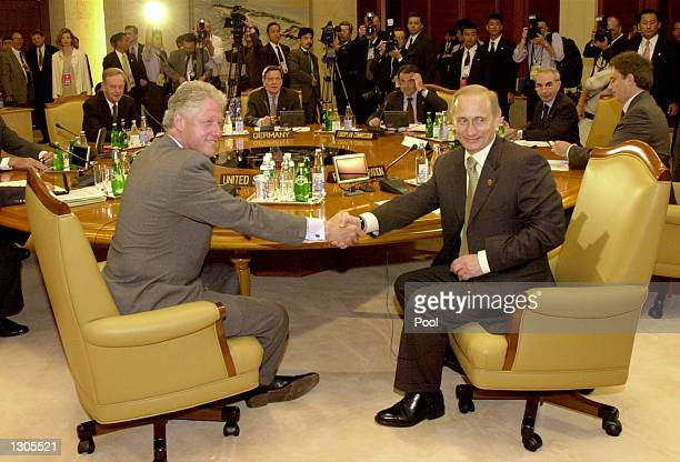 President Bill Clinton, left, and Russian President Vladimir Putin shake hands July 22, 2000 before the start of a meeting during the Group of Eight...