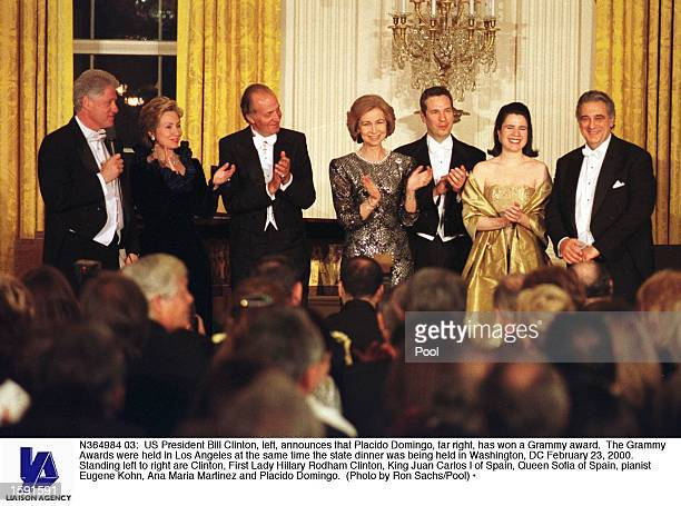 President Bill Clinton, left, announces that Placido Domingo, far right, has won a Grammy award. The Grammy Awards were held in Los Angeles at the...