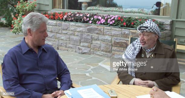 President Bill Clinton, left, meets with Palestinian President Yasser Arafat July 11, 2000 during the Arab-Israeli summit at Camp David in Thurmont,...