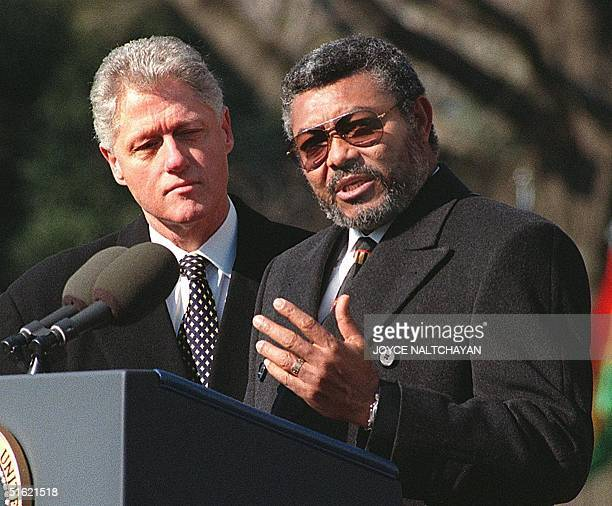 President BIll Clinton listens as Jerry John Rawlings president of Ghana speaks during arrival ceremonies at the White House in Washington DC 24...