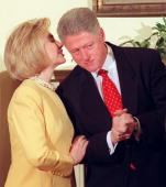 President bill clinton listens to his wife hillary during an event picture id51642443?s=170x170