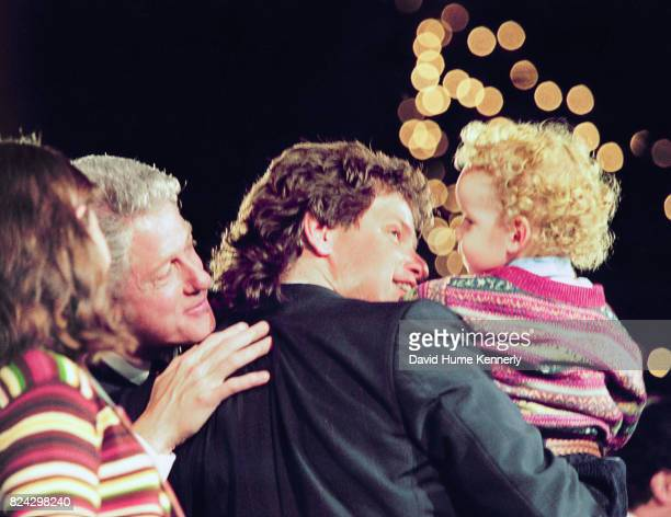 President Bill Clinton on stage at the Old State House as he celebrates his reelection with his halfbrother Roger Clinton nephew Tyler and...