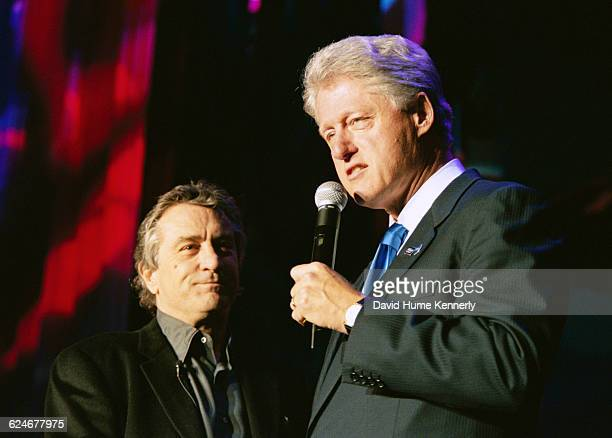President Bill Clinton on stage with Robert De Niro at the 53rd birthday party for his wife Hillary Clinton at the Rosebud Club in New York City on...