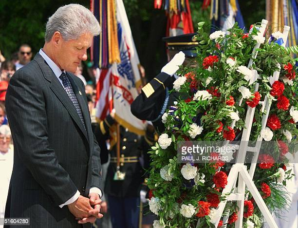 President Bill Clinton pauses after placing a wreath at the Tomb of the Unknown Soldier on the last Memorial Day of the century during services for...