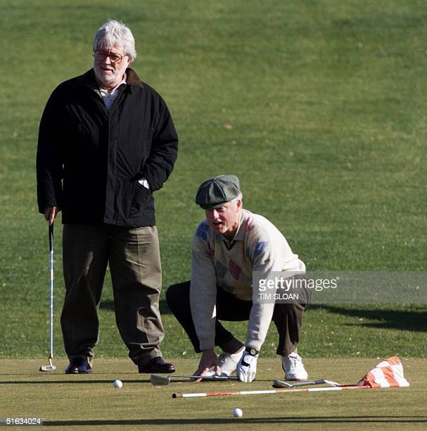 President Bill Clinton plays a round of Thanksgiving golf with friend Harry Thomason 26 November in Thurmont MD This is the ninth time the President...