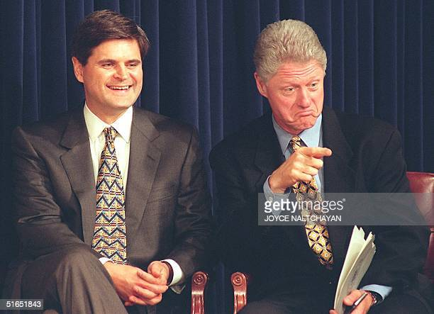 President Bill Clinton points to someone in the audience as CEO of America On Line Steve Case looks on during ceremonies 16 July at the White House...