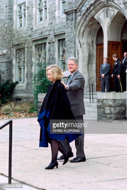 US President Bill Clinton puts his hand on Hillary after attending Sunday services at New Foundry Methodist Church on March 17 1996 in Washington