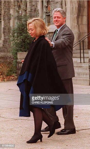 President Bill Clinton puts his hand on Hillary after attending Sunday services at New Foundry Methodist Church in Washington DC 17 March President...
