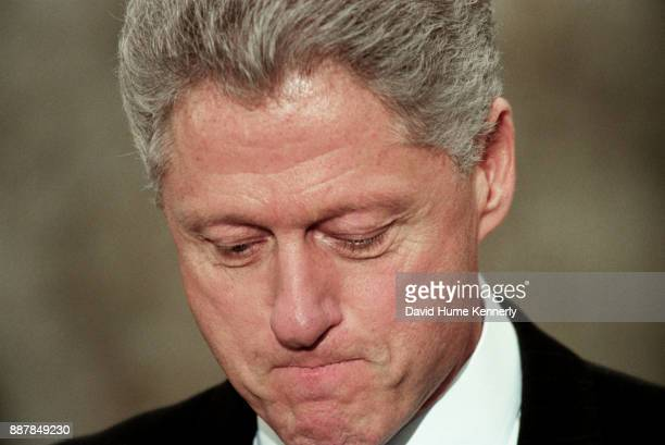 President Bill Clinton reacts to being impeached by the House of Representatives outside of the oval office in the White House Rose Garden Washington...