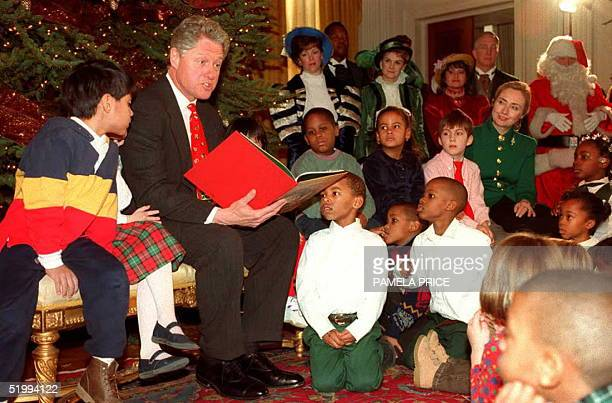 President Bill Clinton reads Clement Clarke Moore's T'was the Night Before Christmas to a group of school children in the State Dining Room at the...