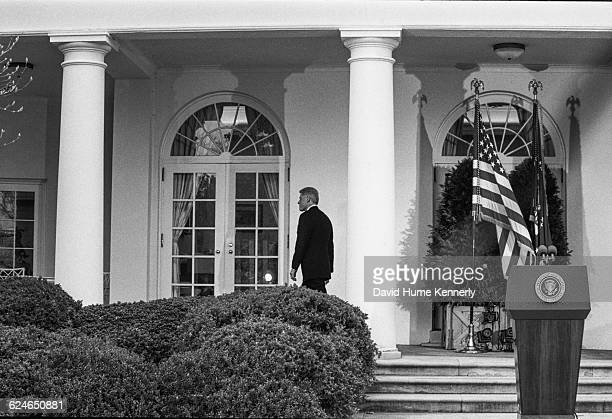 President Bill Clinton returns to the Oval Office after learning that the US Senate voted to acquit him of the charges of perjury and obstruction of...