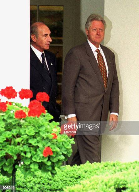 President Bill Clinton right and Argentinian President Fernando de la Rua left leave the Oval Office of the White House after their meeting June 13...