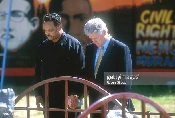 S President Bill Clinton right and the Reverend Jesse Jackson stand at Edmund Pettus Bridge March 5 2000 in Selma Alabama The bridge is the site of...