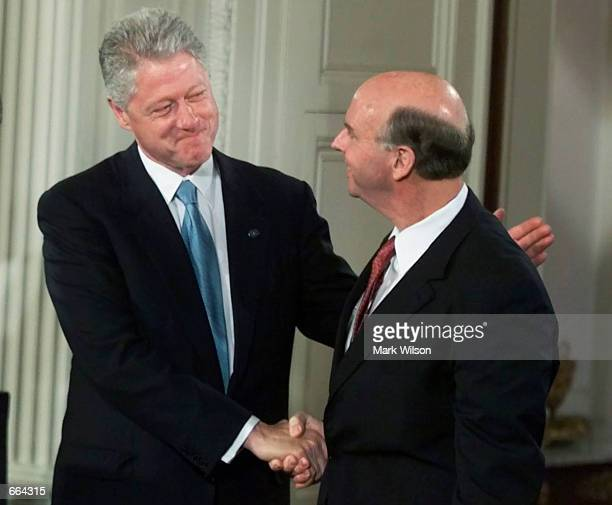 S President Bill Clinton shakes hands with J Craig Venter in the East Room of the White House June 26 2000 Venter's company Celera Genomics...