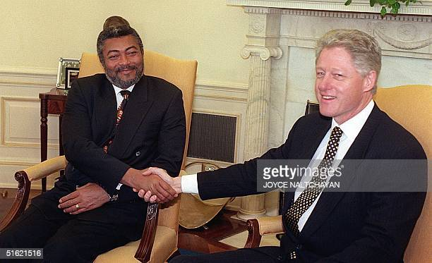 President BIll Clinton shakes hands with Jerry John Rawlings president of Ghana during a visit to the Oval Office at the White House in Washington DC...