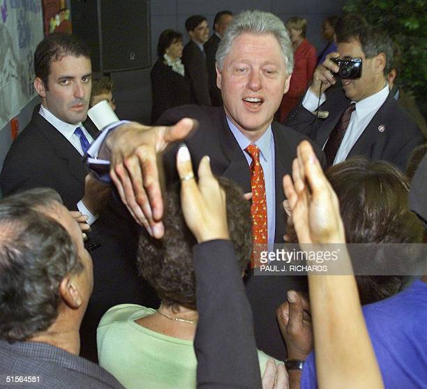 President Bill Clinton shakes hands with the crowd after addressing people at the Westchester County Jewish Community Center 11 September 2000 in...