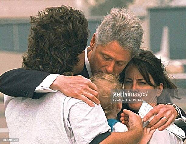 President Bill Clinton shares a family hug with his brother Roger sisterinlaw Molly and nephew Tyler as he says goodbye on the tarmac at Santa Monica...