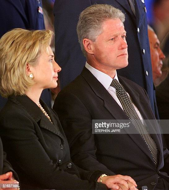 President Bill Clinton sheds a tear beside First Lady Hillary Rodham Clinton during a ceremony 13 August at Andrews AFB in Maryland honoring the men...