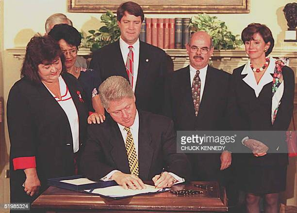 President Bill Clinton signs the Ryan White Comprehensive AIDS Resources Emergency Act Amendments of 1996 20 May at the White House in Washington DC...