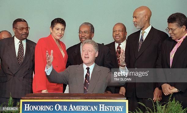 President Bill Clinton sits in front of members of the Little Rock Nine Jefferson Thomas Carlotta Wall LaNier Ernest Green Rep Elijah Cummings...