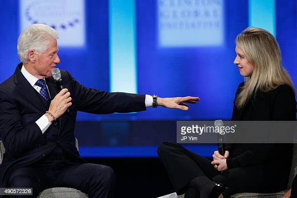 S President Bill Clinton speaks as Elizabeth Holmes founder and CEO of Theranos listens during the closing session of the Clinton Global Initiative...