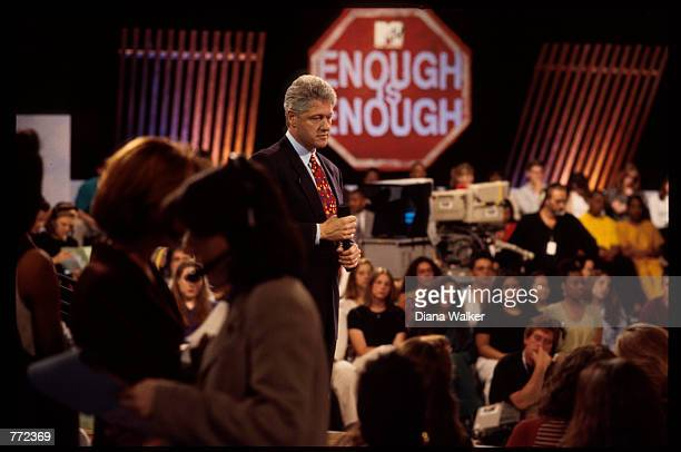 President Bill Clinton speaks to an audience of teenagers on MTV's Enough is Enough forum April 19 1994 in Washington DC Clinton explained that even...