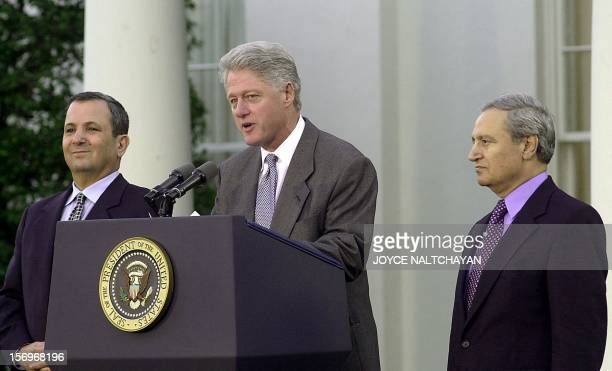 US President Bill Clinton speaks to reporters as Israeli Prime Minister Ehud Barak and Syrian Foreign Minister Faruq alShara look on during a press...