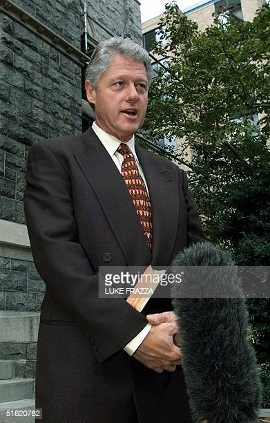 President Bill Clinton speaks to reporters outside the Foundry United Methodist Church 31 October 1999 in Washington after attending Sunday service...