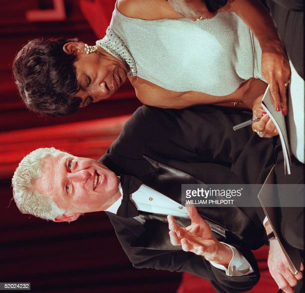 President Bill Clinton speaks with US Representative Maxine Waters at the Congressional Black Caucus' Gala in Washington DC 13 September