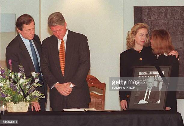 President Bill Clinton stands before signing the condolence book for the late Israeli Prime Minister Yitzhak Rabin at the Israeli Embassy in...