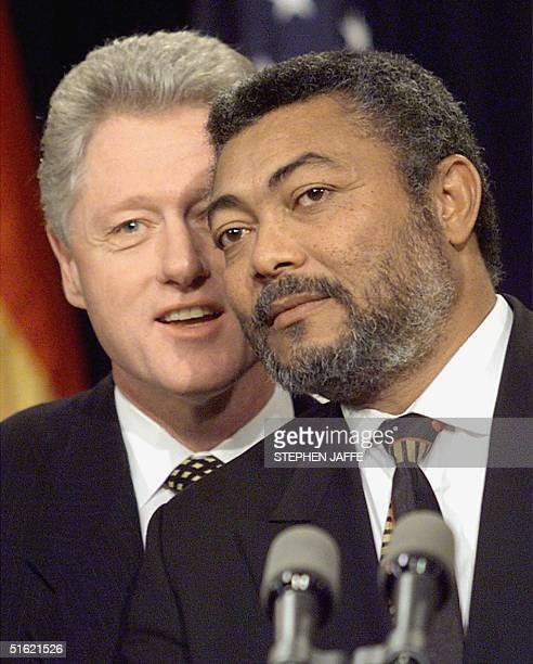 President Bill Clinton stands behind Ghana's President Jerry John Rawlings at the end of their joint press conference at the White House 24 February...