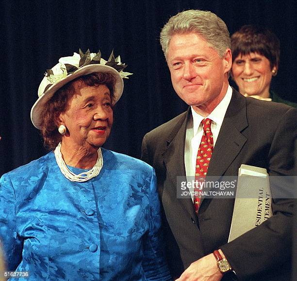 President Bill Clinton stands next to Dr Dorothy Height 10 June during ceremonies in which Clinton commemorated the 35th anniversary of the signing...