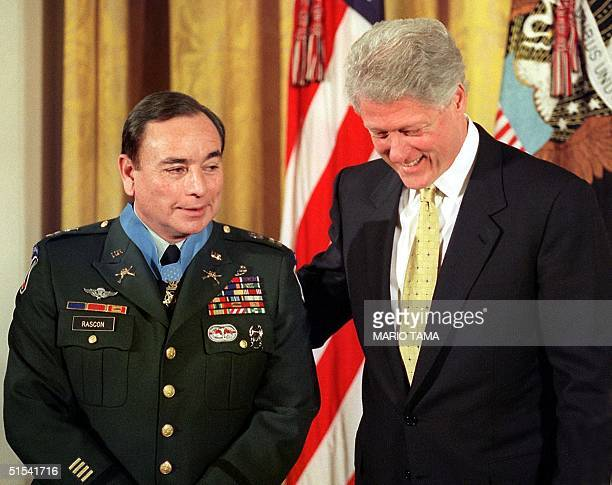President Bill Clinton stands next to US Army Captain Alfred Rascon after Clinton presented him with the Congressional Medal of Honor in ceremonies...