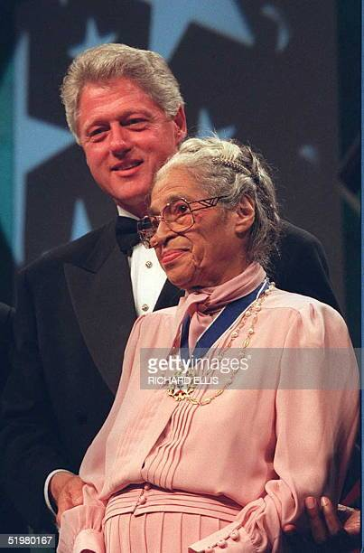 President Bill Clinton stands with civil rights activist Rosa Parks during the Congressional Black Caucus dinner 14 September in Washington DC....