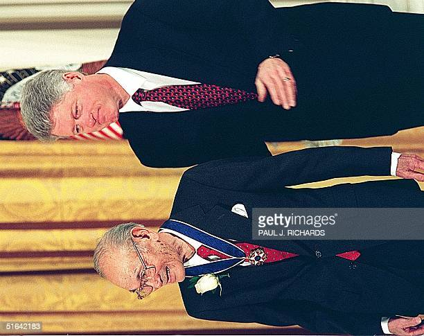 President Bill Clinton stands with Fred Korematsu after awarding him the Presidential Medal of Freedom the nation's highest civilian honor 15 January...