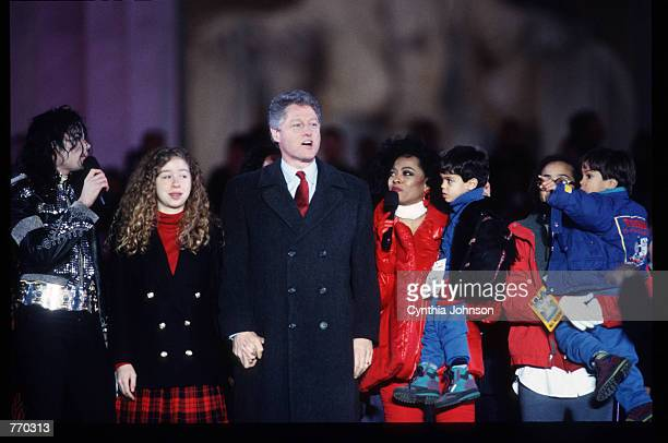 President Bill Clinton stands with his daughter Chelsea and musical performers in front of the Lincoln Memorial January 17 1993 in Washington DC...