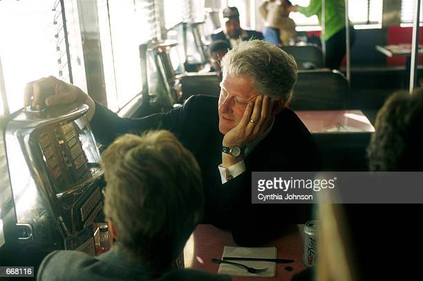 President Bill Clinton stops en route to an event at the Jackson Hole Diner October 23 2000 in Queens NY