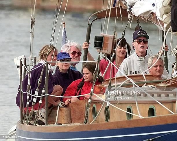 US President Bill Clinton takes the helm of Senator Ted Kennedy's 52foot schooner Mya in Vineyard Sound at Martha's Vineyard MA 20 August The...