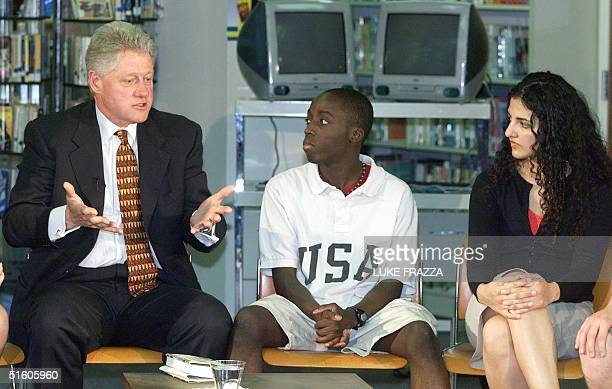President Bill Clinton talks to students including Tony GyepiGarbrah and Zohra Atmar about school violence 22 April 1999 at TC Williams High School...