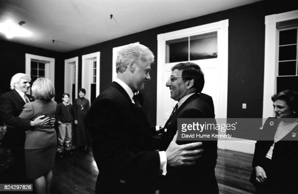 President Bill Clinton talks with White House Chief of Staff Leon Panetta on election night backstage at the Old State House Little Rock Arkansas...