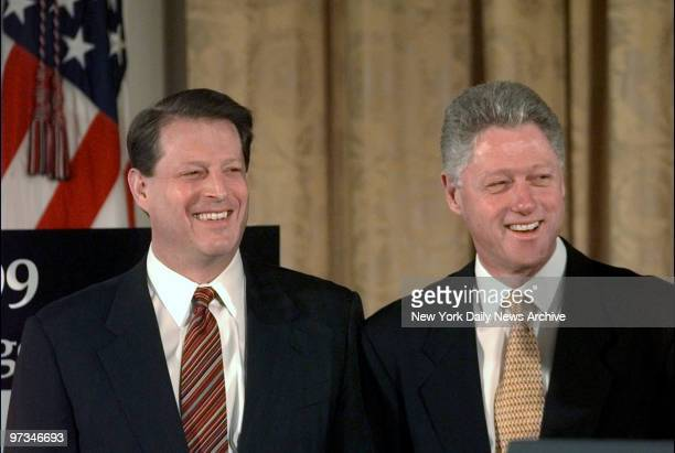 President Bill Clinton unveils his $17 trillion balanced budget for fiscal year 1999 in the East Room of the White House With him is Vice President...