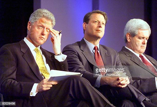 President Bill Clinton Vice President Al Gore and Speaker of the House Newt Gingrich sit together at the National Summit on Retirement Savings event...