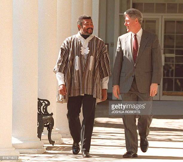 President Bill Clinton walks along the Colonnade at the White House in Washington 09 March with Jerry Rawlings president of Ghana Clinton and...
