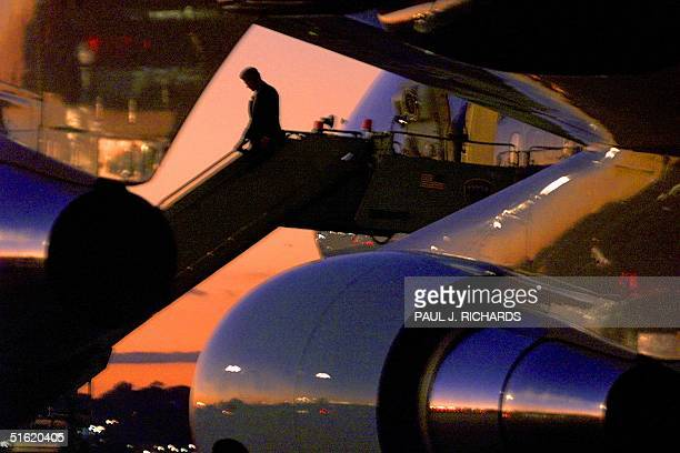 President Bill Clinton walks down the steps of Air Force One 18 October 1999 at the Newark New Jersey airport to attend the Democratic Victory '99...