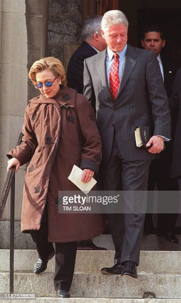 US President Bill Clinton walks down the steps of Foundry Methodist Church with First Lady Hillary Clinton after they attended services with their...
