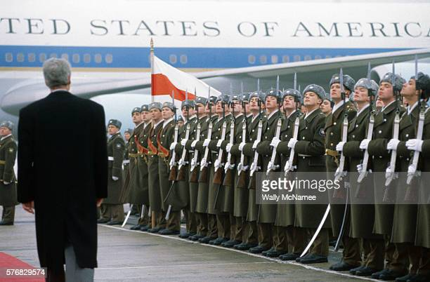 President Bill Clinton walks past an honor guard at a Moscow airport as he departs for Minsk Be following a summit meeting with Boris Yeltsin
