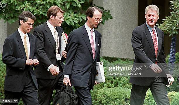 President Bill Clinton walks through the Rose Garden at the White House before departing for Denver Colorado 19 June as Chief of Staff Erskine Bowles...