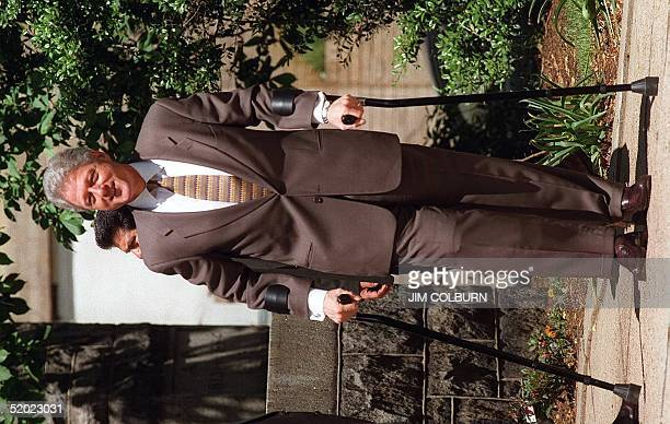 President Bill Clinton walks to a waiting limousine after attending services at the Foundry United Methodist Church in Washington DC 04 May