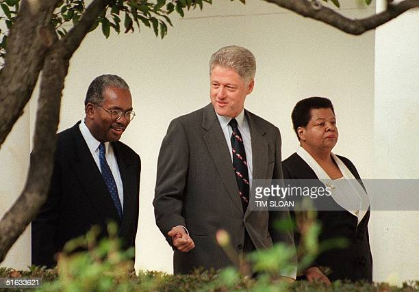 President Bill Clinton walks with Ernest Green and Elizabeth Eckford two of the original Little Rock Nine who integrated Little Rock Central High...